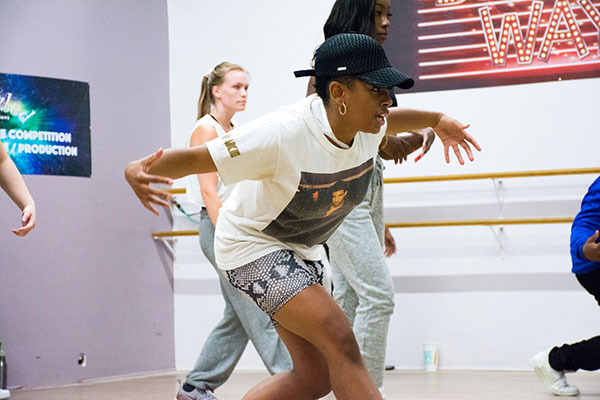 A female dance instructor leads a workshop